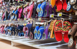 Different slippers ready to sale at showcase in new hypermarket Royalty Free Stock Image