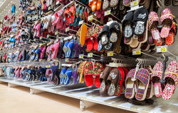 Different slippers ready to sale at showcase in new hypermarket Royalty Free Stock Images