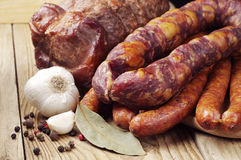 Different smoked sausage and meat Royalty Free Stock Photography