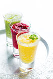 Different smoothie on white background Royalty Free Stock Photography