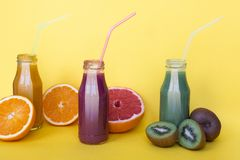 Different smoothies or juices in bottles, healthy diet food concept. stock photo