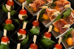 Different snack on skewer in mini box Stock Photo