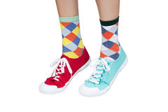 Different sneakers and socks Stock Photography