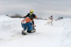 On different snowmobiles stock photography