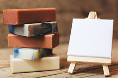 Different soaps with empty board Stock Image
