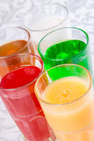 Different soft drinks in a glass. On table Royalty Free Stock Photos