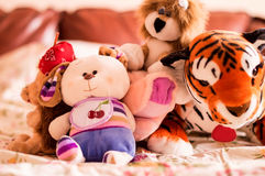 Different soft toys for children on the couch Royalty Free Stock Images