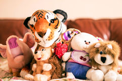 Different soft toys for children on the couch Royalty Free Stock Photo