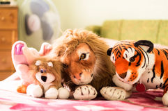 Different soft toys for children on the couch Royalty Free Stock Image