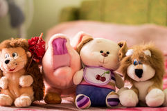 Different soft toys for children on the couch Royalty Free Stock Photography