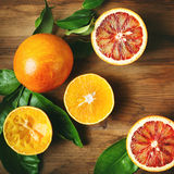 Different sort of orange fruit on wooden table Royalty Free Stock Photos