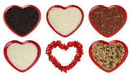 Different sort of rice and goji berryes heart stock photo