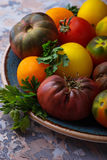 Different sort of tomato on concrete background Royalty Free Stock Images