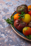 Different sort of tomato on concrete background Royalty Free Stock Photography