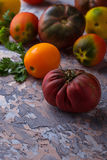 Different sort of tomato on concrete background Royalty Free Stock Image