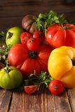 Different sort of tomatoes. On wood Royalty Free Stock Photo