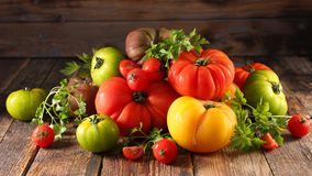Different sort of tomatoes. On wood Royalty Free Stock Image