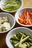 Different sort of vegetables. Different sort of cut raw vegetables in small cup Royalty Free Stock Photography