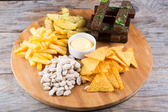 Different sorts of beer snacks. Diferent beer snacks served on a round board Royalty Free Stock Photos