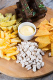 Different sorts of beer snacks. Diferent beer snacks served on a round board Stock Photos