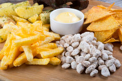 Different sorts of beer snacks. Diferent beer snacks served on a round board Stock Images