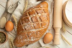 Different sorts of bread with wheat and eggs, top view. The concept of a bakery and food store. royalty free stock images