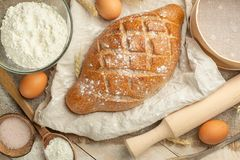 Different sorts of bread with wheat and eggs, top view. The concept of a bakery and food store. stock photo