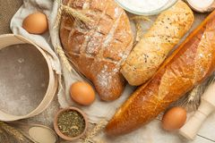 Different sorts of bread with wheat and eggs, top view. The concept of a bakery and food store. stock photography
