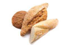 Different sorts of bread - wheat, rye and multi grain on white background stock images