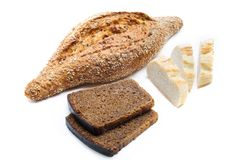 Different sorts of bread - wheat, rye and multi grain on white background royalty free stock image