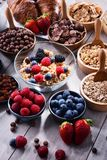 Different sorts of breakfast cereal products and fresh fruits. Composition with different sorts of breakfast cereal products and fresh fruits Stock Photos