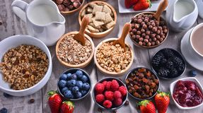 Different sorts of breakfast cereal products and fresh fruits. Composition with different sorts of breakfast cereal products and fresh fruits Royalty Free Stock Images
