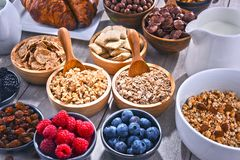 Different sorts of breakfast cereal products and fresh fruits. Composition with different sorts of breakfast cereal products and fresh fruits Stock Photo