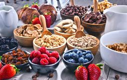 Different sorts of breakfast cereal products and fresh fruits. Composition with different sorts of breakfast cereal products and fresh fruits royalty free stock photography