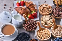 Different sorts of breakfast cereal products and fresh fruits. Composition with different sorts of breakfast cereal products and fresh fruits Stock Image