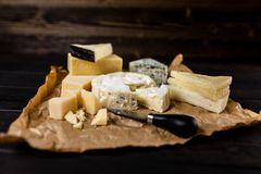 Different sorts of cheese. On dark slate background Royalty Free Stock Images