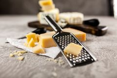 Different sorts of cheese. On dark slate background Royalty Free Stock Photo