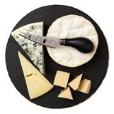 Different sorts of cheese. On dark slate background Royalty Free Stock Image