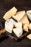 Different sorts of cheese. On dark slate background Stock Photography