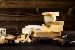 Different sorts of cheese. On dark slate background Stock Images