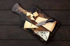 Different sorts of cheese. On dark slate background Royalty Free Stock Photos