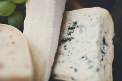 Different sorts of cheese, food background Royalty Free Stock Photos