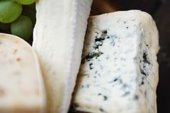 Different sorts of cheese, food background Royalty Free Stock Images