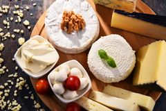 Different sorts of cheese on kitchen table.  Stock Image
