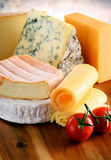 Different sorts of cheese on kitchen table Stock Photography