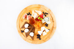 Different sorts cheese plate. Different sorts cheese wooden plate Royalty Free Stock Image