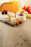 Different sorts of cheese on wooden table Royalty Free Stock Photo