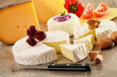 Different sorts of cheese on wooden table Stock Photo