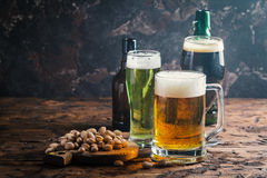 Different sorts of craft beer. Glasses with different sorts of craft beer on wooden table Stock Image
