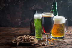 Different sorts of craft beer. Glasses with different sorts of craft beer on wooden table Stock Photo